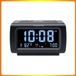 Dream sky descent Alarm clock radio with FM radio, USB port for charging.