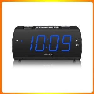 Dream sky digital alarm clock radio with USB charging cable.